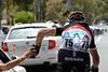 Hayden Roulston collects bottles for his new Radio-Shack-Nissan-Trek teamates...