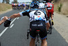 Nathan Hass collects feed-bags for his new teamates at Garmin-Barracuda...