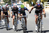 Despite their rivalry, Roulston lends a helping hand to Movistar's Gutierrez in order to keep the racing-line intact...