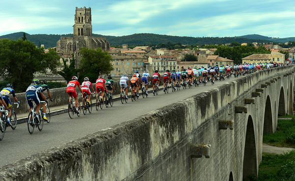 The peloton races across the Pont de Saint-Esprit after about 20-kilometres...