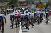 The peloton has split into many pieces on the windswept road to Sete...