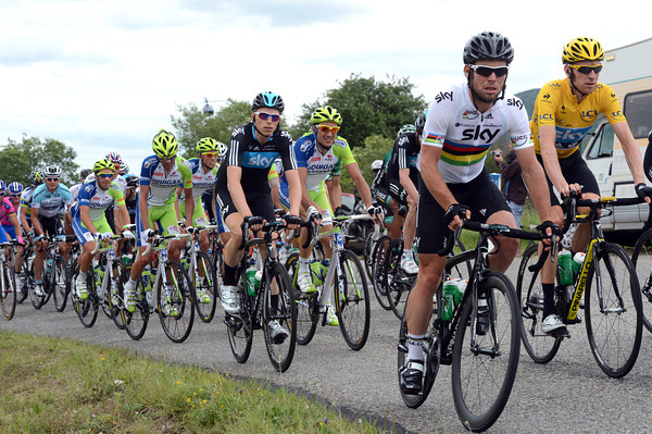 Mark Cavendish is at the front of a peloton led sedately by Team Sky...