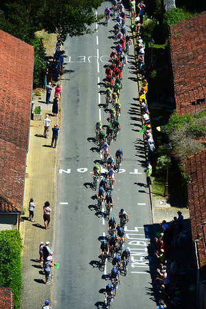 The peloton races through a typical village in Haute Pyrenees...