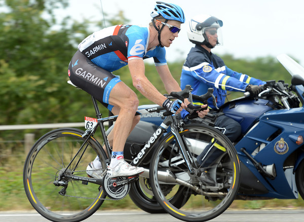 Tyler Farrar gets his personal Gendarme escort after a crash caused by a stray dog...