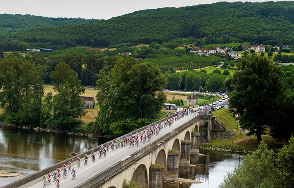 The peloton crosses the Dordogne river at Souhillac, about 45-kilometres from the finish...