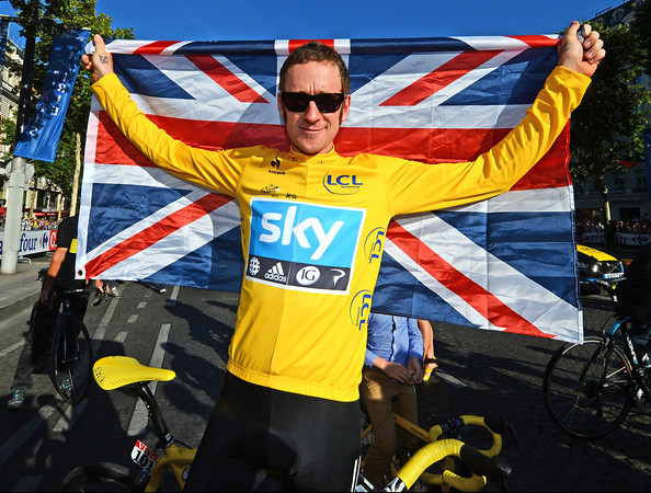 Bradley Wiggins shows off his patriotism with a Union flag over his shoulders...