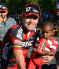 Cadel Evans hides his disappointment by playing with his son Robel...
