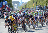 Wiggins and Cavendish are up-front and out of danger as the peloton swoops down the Champs Elysees...