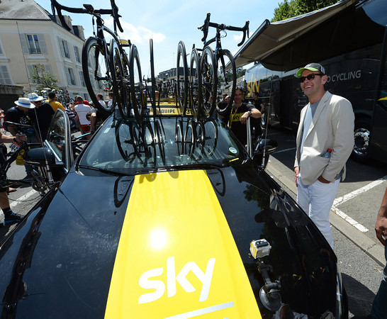 James Murdoch stands beside a newly-decorated Sky car in Rambouillet - rumour has it the infamous businessman was up all night applying the yellow paint..!