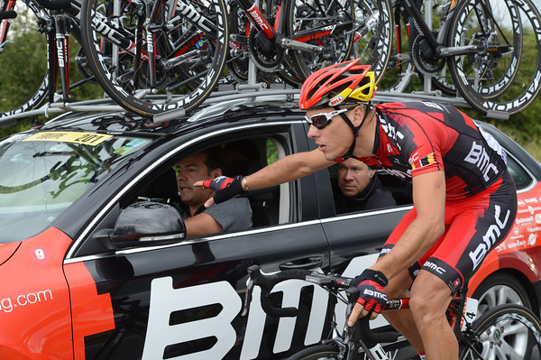 Philippe Gilbert comes back for bottles and advice on how to win this hilly stage...