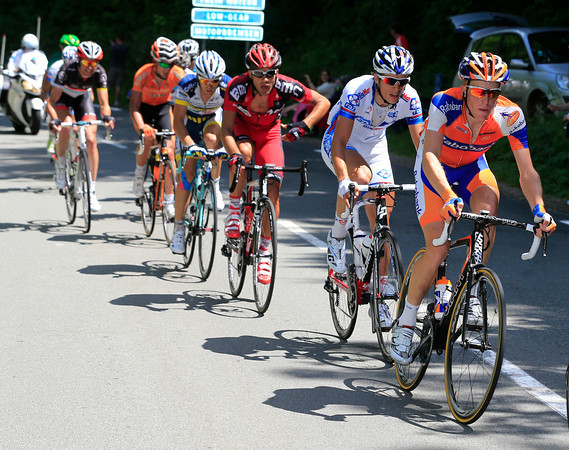 Gilbert and Voigt are in another move that is led by Bauke Mollema...