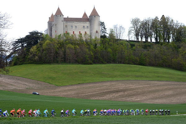 The peloton speeds past a famous Chateau in the Orbe valley...