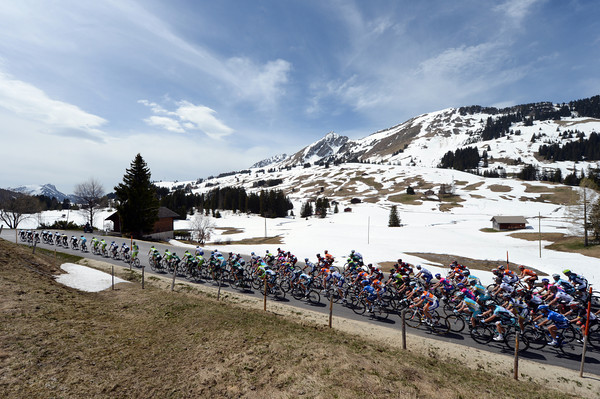 Summertime, summertime - but there's still a hint of winter as the peloton crosses the Col des Mosses...