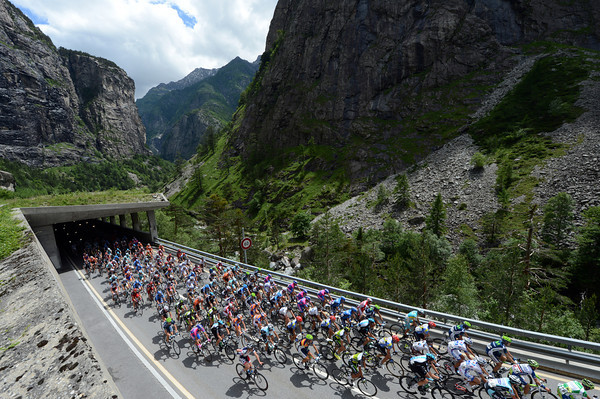 The peloton emerges from a tunnel - and there are plenty more to come..!