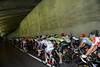 The peloton enters another tunnel as the Simplon Pass continues to rise, and rise...