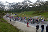 The peloton finally arrives at the summit of the Simplon Pass, but it's taken a while...