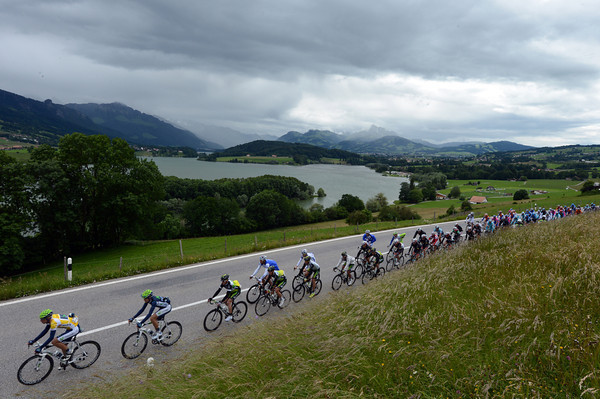 The peloton speeds past the lake of Gruyere, still nine-minutes behind the escape with a tailwind helping them stay away...