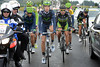Half of the teams of Movistar and Green Edge are ahead, but race-officials insist they wait for the peloton...