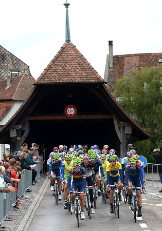 Movistar leads out stage four from Aarberg and its sheltered wooden bridge...