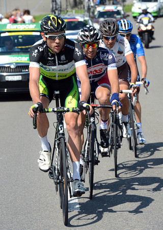 Baden Cooke has got away in a four man escape that's designed to draw the sting out of Peter Sagan's Liquigas team...