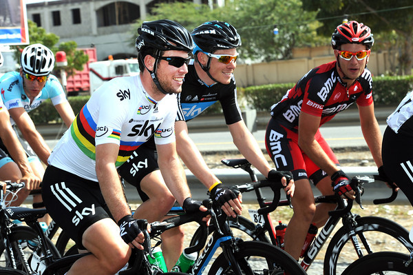 Three other riders swap jokes - Cavendish, Luke Rowe, and Adam Blythe...