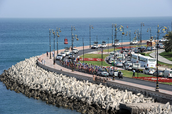 Stage one of the Tour of Oman trickles along The Corniche during a short neutralised section...