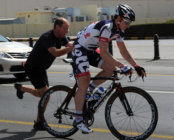 Greipel makes a wheel-change, his mind totally on the finish-sprint today...