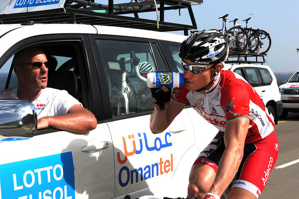 Greipel himself seems happy too - he's fetching water-bottles for his loyal teamates...