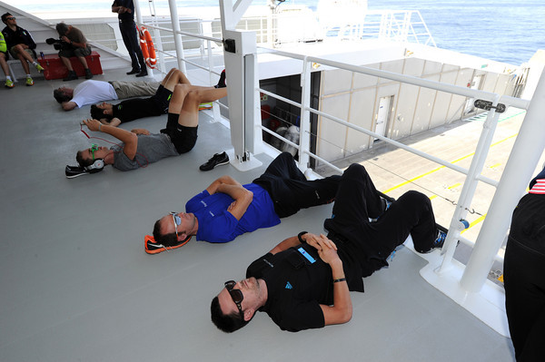 The big swell on the Oman Sea means some cyclists - as well as Eddy Merckx - have to lie down to avoid being sick...