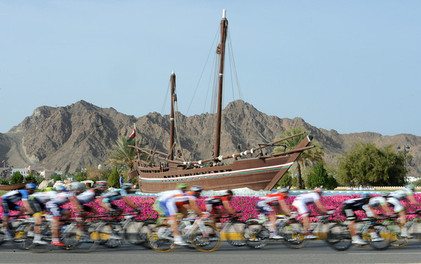 The peloton passes a well-known landmark on the outskirts of Muscat...