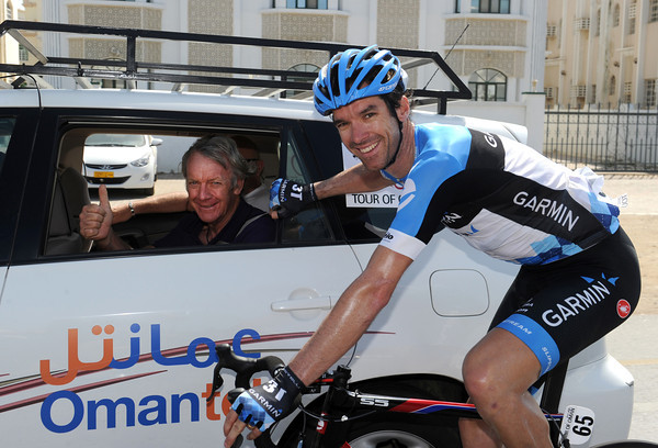 David Millar ignores the chaos behind the peloton to pose for a photo with his father - hello Dad..!