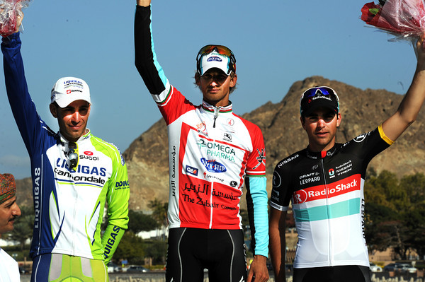 Peter Velits celebrates his first win for Omega Pharma-Quick-Step, with Vincenzo Nibali and Tony Gallopin alongside him in Muscat