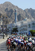 The peloton arrives on the Corniche in Muscat, about two minutes down on the trio in front...