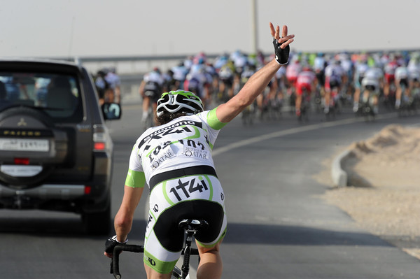 Roy Curvers makes a cry for help, another puncture victim on the gritted roads of Qatar...