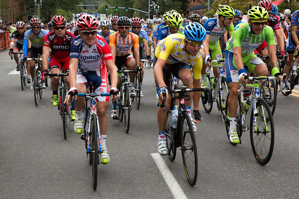 Christian Vande Velde adjusts his shoe as the peloton rolls out of Aspen towards Independence pass...