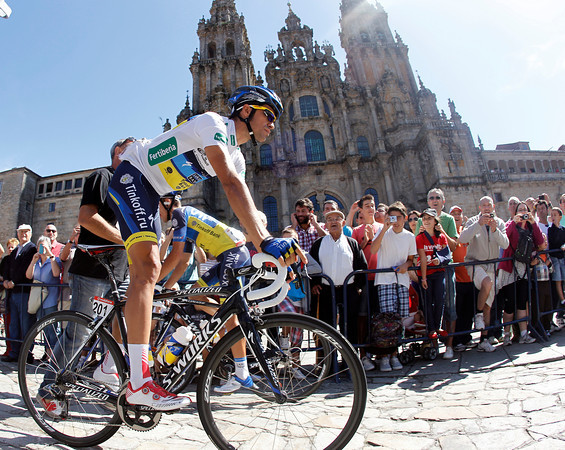 No ordinary pilgrim - Alberto Contador arrives to sign-on in front of the famous cathedral in Santiago de Compostela...