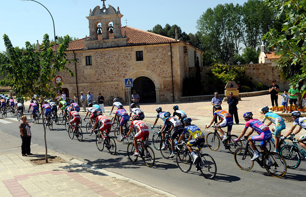 The peloton passes a monastery somewhere in Castilla y Leon...