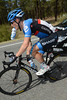 Andrew Talansky does a bit of multi-tasking while changing water bottles...