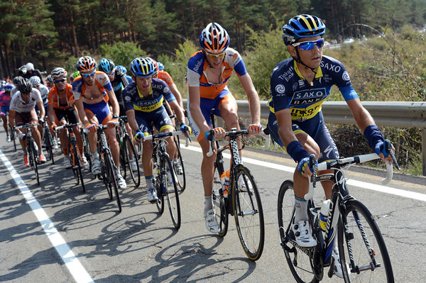 Jesus Hernandez is leading the peloton in wary pursuit - the temperatures have soared and made life difficult for everyone after the earlier chill...
