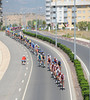 The peloton strings out along a crowded road near Logroño..!
