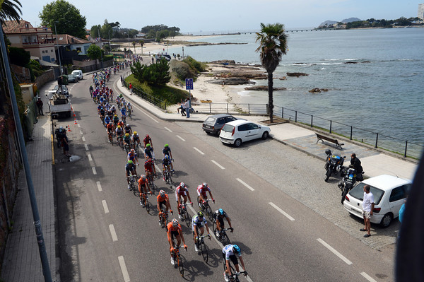 A sauntering peloton hits the Galician coast near Vigo, they are about four minutes down...