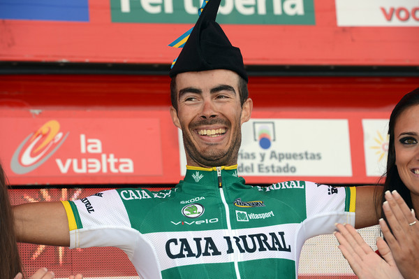 Antonio Piedra enjoys the spoils of his victory atop Covadonga - what a great day for Caja Rural..!