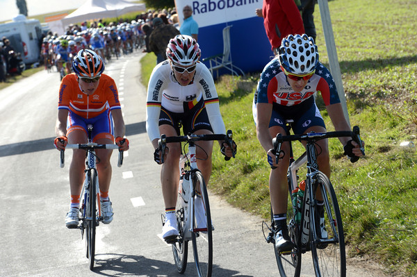 Another Dutch girl is in an escape led by USA's Kristin McGrath...