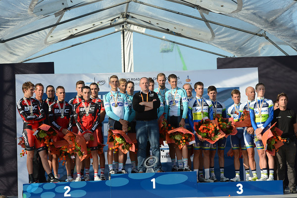 World Champions but no rainbow jersey - Omaga pose with BMC and Orica-Green Edge on the crowded podium...