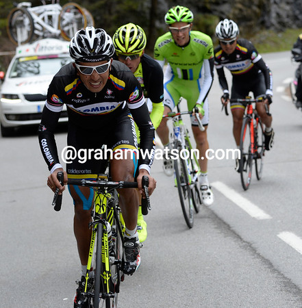 The bus is leaving! A Colombian sprints across the gap to the escape with Danilo Di Luca on his wheel...
