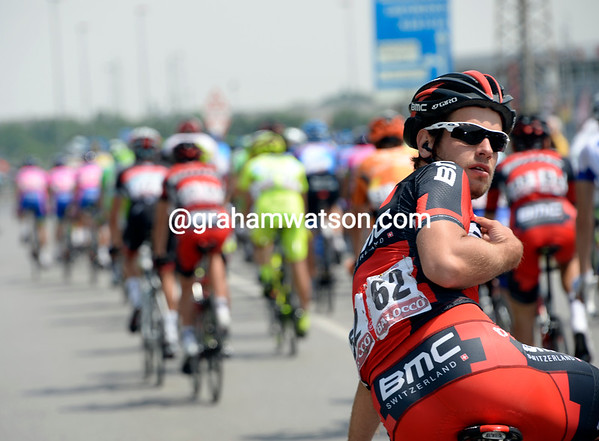 Adam Blythe is looking back for his team car and Cadel Evans' own feed-bag...