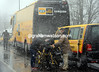 Cyclists begin to stop at their buses in Ovada, where the snow is at its heaviest...