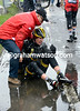 An MTN rider ends his day sitting in a cold puddle...