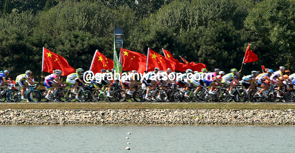 The stage begins with a pass down both sides of the Olympic Rowing course, cheered by Chinese fans...