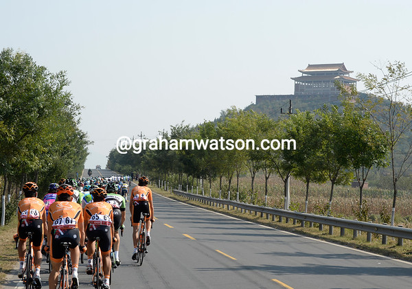 The peloton is strung out in the Beijing countryside...